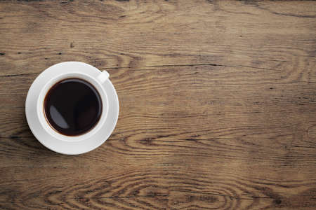 view from the above: Black coffee cup on old wooden table Stock Photo