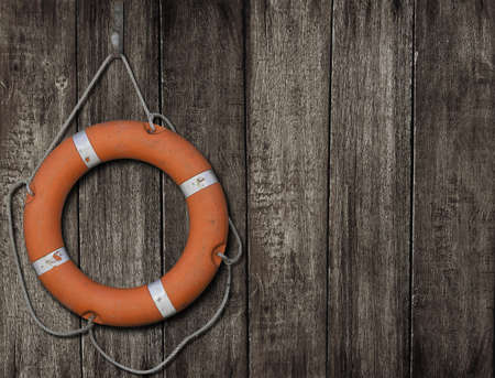 Lifebuoy on dark wood background