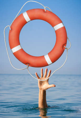 hand water: Lifebuoy for drowning mans hand in open sea or ocean water. Stock Photo