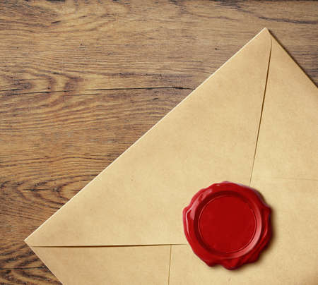 Old letter envelope with wax seal isolated on white Stock Photo