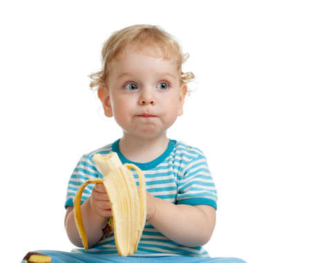 eating banana: Kid boy eating banana isolated on white