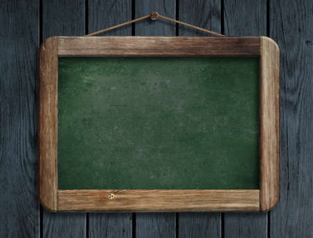 Aged green menu blackboard hanging on wooden wall photo
