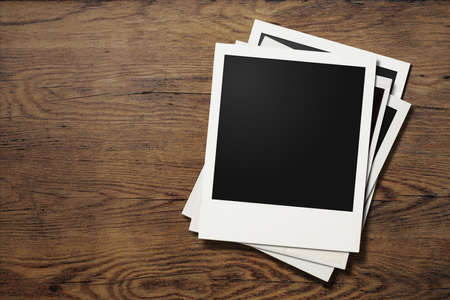 background pictures: polaroid photo frames on old wooden background