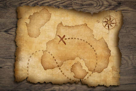 wall maps: Pirates old parchment treasure map on wood table Stock Photo