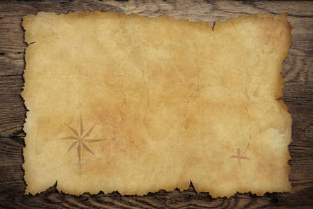 Pirates\' old parchment treasure map on wood background
