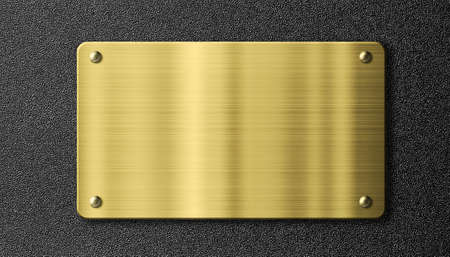 gold or brass sign metal plate over black background photo