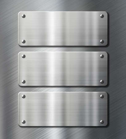 stainless: three stainless steel metal plates over black background