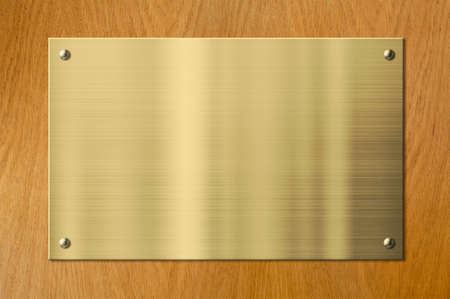 plaque: gold plaque on wood background