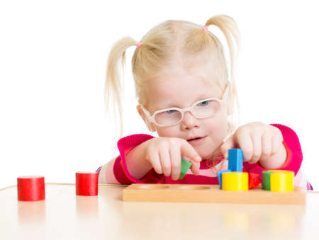 hyperopia: Child in eyeglases playing logical game isolated on white Stock Photo