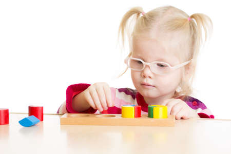 logical: Kid in eyeglases playing logical game isolated on white