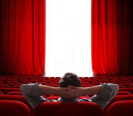 cinema screen red curtains opening for one vip person photo