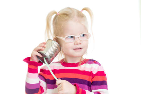 tin can phone: Funny kid in eyeglasses using a can as a telephone isolated on white