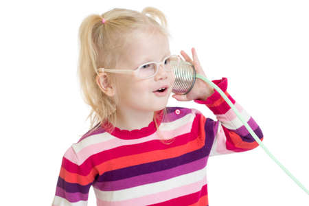 tin can phone: Funny child in eyeglasses using a can as a telephone isolated on white