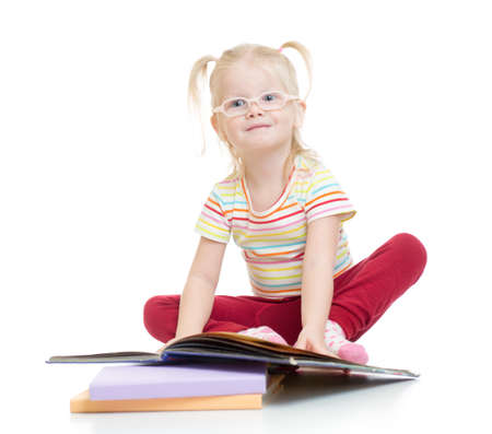 hyperopia: Funny kid in eyeglases reading book isolated on white