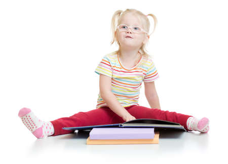 hyperopia: Funny kid in eyeglases reading book isolated on white background