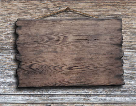 driftwood: old wood plank or plate hanging on timber plank wall background