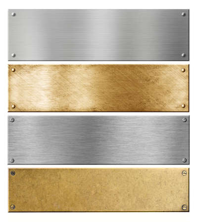 plaque: silver and brass metal plates or plaques with rivets set Stock Photo