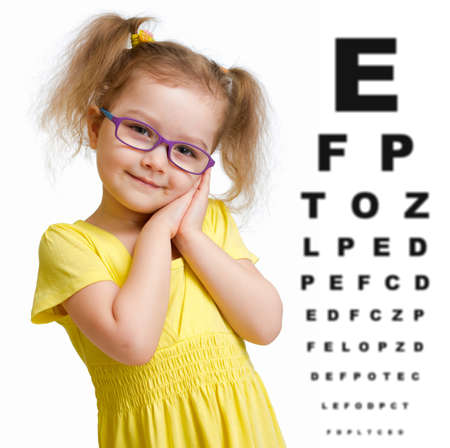 poor eyesight: Smiling girl in glasses with eye chart isolated