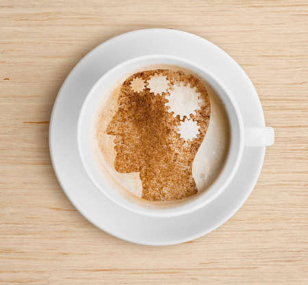 Coffee cup with brain on foam 写真素材
