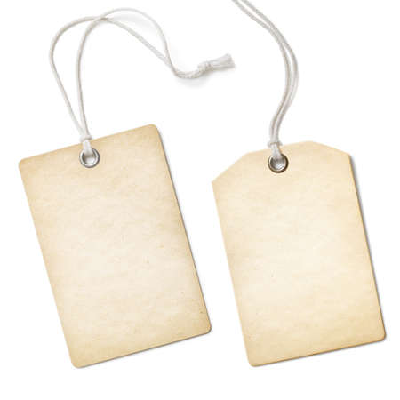 Blank old paper cloth tag or label set isolated on white photo