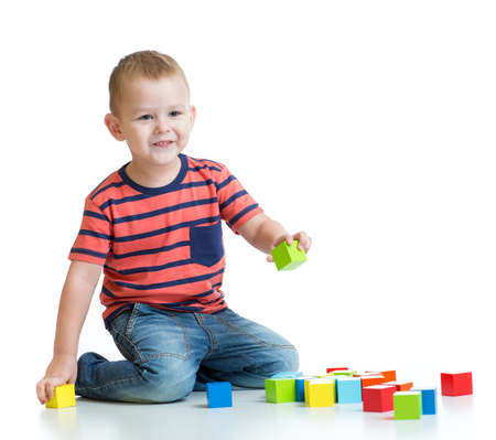 tower block: Kid building tower with colorful blocks isolated