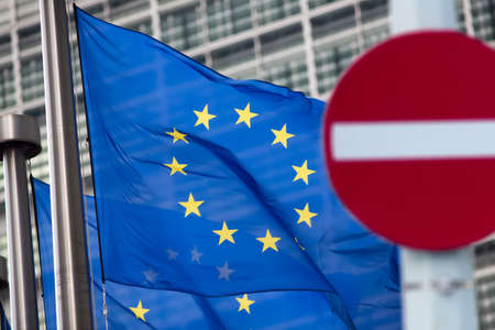 the european economic community: Russia sanctions. No entry sign in front of European comission flags.