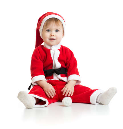 Adorable Christmas baby in Santas clothes isolated