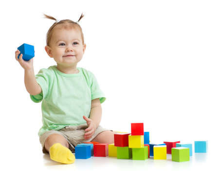 baby playing with colorful building blocks isolated Stock Photo