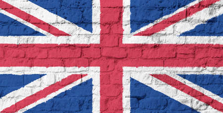 The United Kingdom flag on brick wall background photo