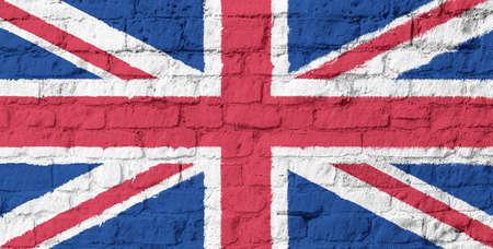 uk flag: The United Kingdom flag on brick wall background Stock Photo