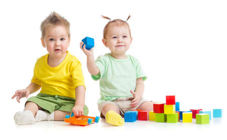 Adorable children playing colorful toys isolated Stock Photo