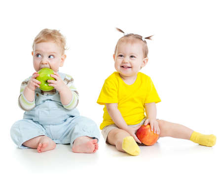 baby boy: Baby boy and girl eating apples isolated