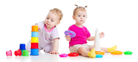Adorable kids playing with colorful towers isolated photo