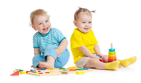 girl sit: Adorable kids playing educational toys isolated