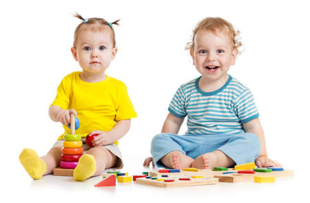 sit studio: Funny kids playing educational toys isolated Stock Photo