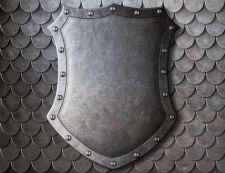 metal grunge: old medieval coat of arms shield over scales armour background Stock Photo