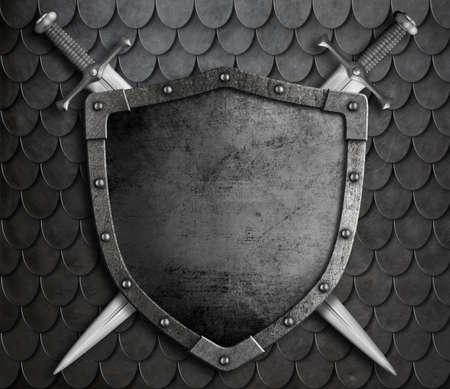 espadas medievales: escudo medieval con dos espadas cruzadas en escalas de armadura fondo
