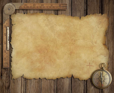 parchment texture: old treasure map on wooden desk with compass and ruler