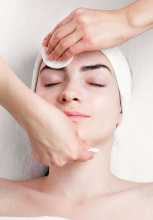 remover: Young woman facial make up removing in beauty parlour