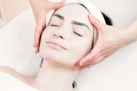 dayspa: Young woman facial massage in beauty parlour Stock Photo