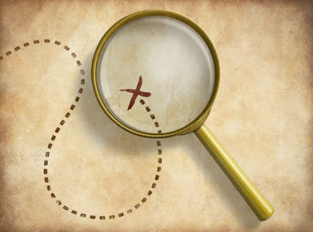 Magnifying glass and track with marked location on old map. Path finding concept. Stock Photo