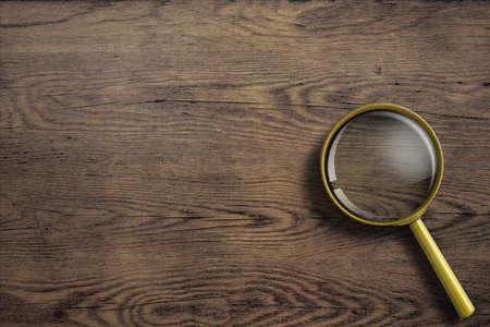 magnifier glass: magnifying glass or loupe on wooden table Stock Photo