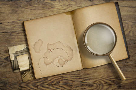 Adventure and travel theme. Diary with magnifying glass or loupe.