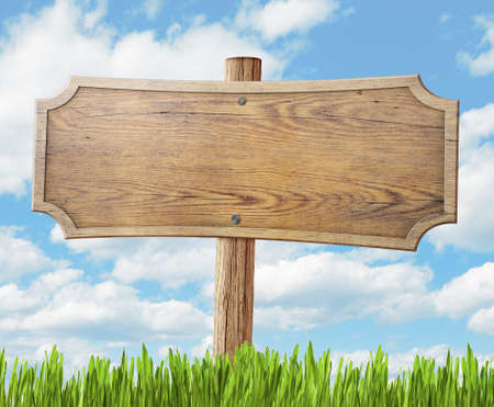 wood road sign on grass and sky background Stok Fotoğraf