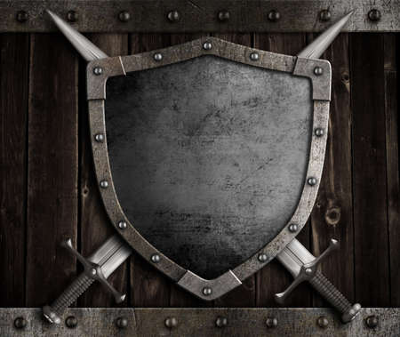 medieval knight shield and crossed swords on wooden gate Stockfoto