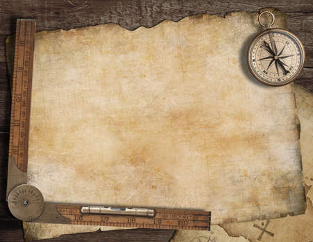 Blank treasure map background with, old compass and ruler. Adventure concept. Foto de archivo
