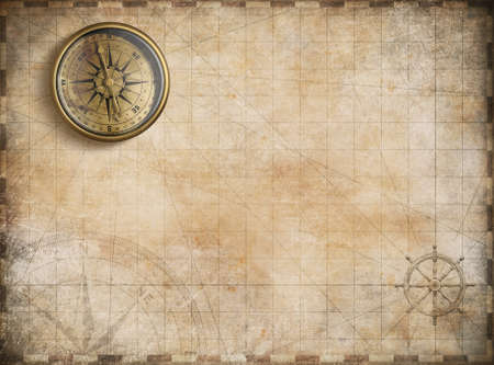 travel map: vintage golden compass with nautical map background