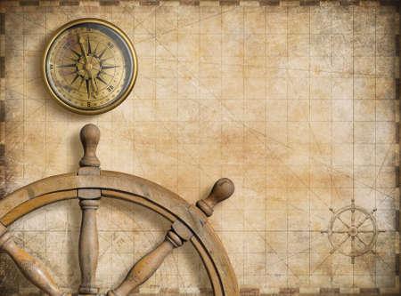 ステアリング ホイールとビンテージの航海地図とコンパス