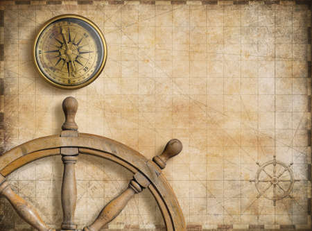 steering wheel and compass with vintage nautical map 스톡 콘텐츠