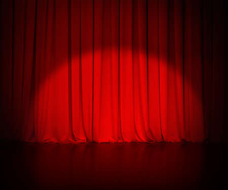 comedy: theatre red curtain or drapes background with light spot